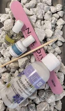 Manicuresæt med creme, olie, fil og rosenpind